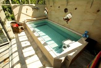 Endless swimming pool inside an Alitex bespoke conservatory
