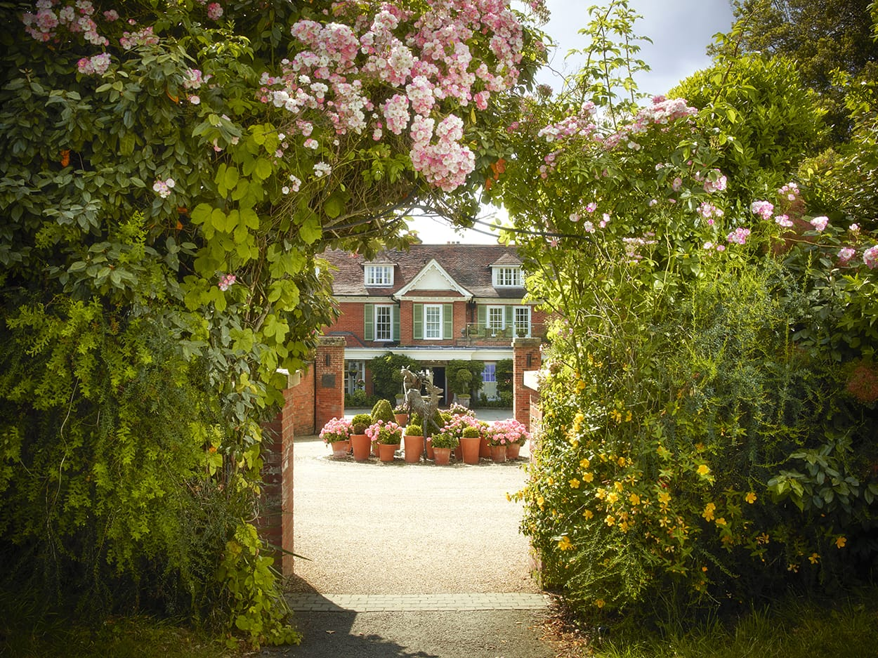 Chewton Glen - Exterior Shot - Entrance with Roses