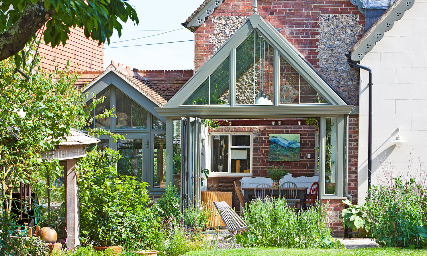 Bi-fold doors have really opened up the ground floor of this cottage