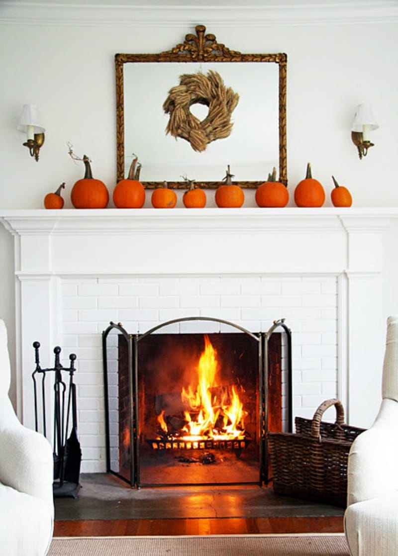 Pumpkins by the fireplace