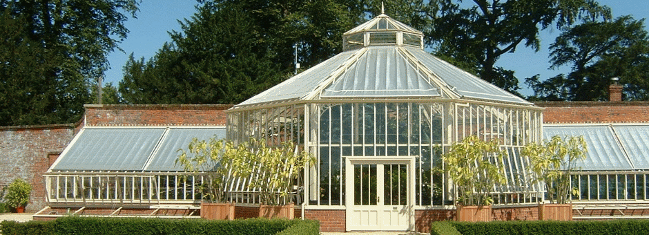 A large bespoke Victorian greenhouse with central hexagon palm house in large walled garden