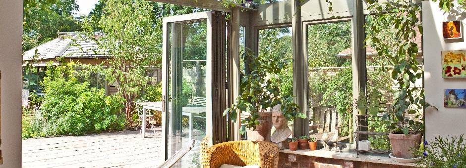 bi-fold doors in an an aluminium conservatory really open up the garden
