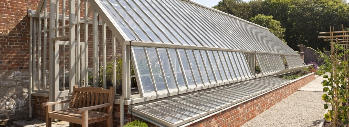 Bespoke Greenhouse flanked by Cold Frames
