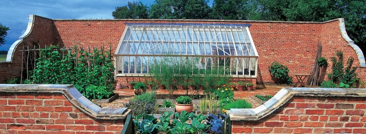 Bespoke monopitch greenhouse in a walled vegetable garden