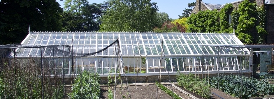 3/4 span, lean-to, messenger greenhouse in off-white as director of Kew's walled garden