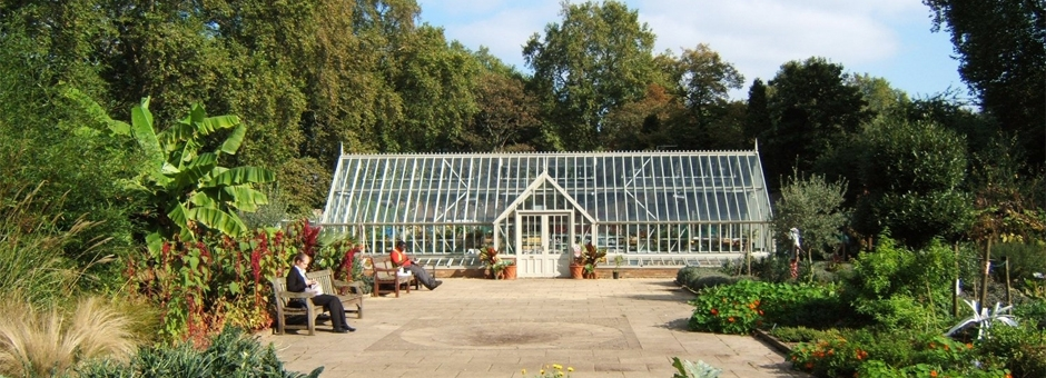 Large free standing Victorian greenhouse in the gardens of charity Thrive in Battersea Park, London