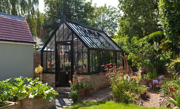 A National Trust Scotney freestanding greenhouse in black