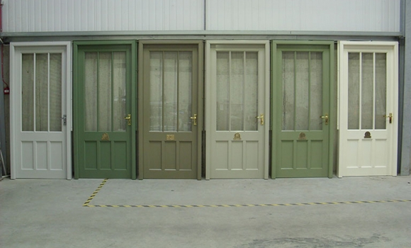 Doors in our factory showing some shades of green available for your greenhouse