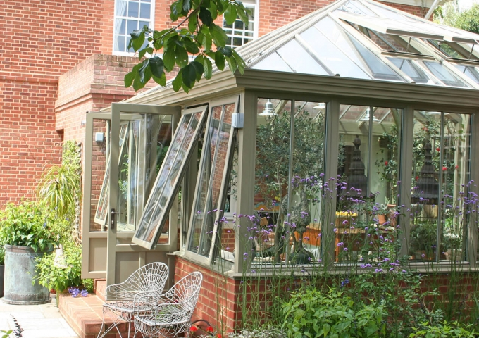 A large square conservatory on a large Georgian farmhouse