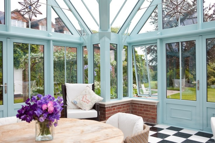 Blue conservatory with chequerboard flooring