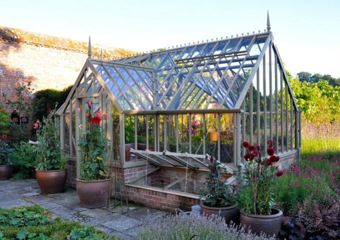 Freestanding bespoke greenhouse with lobby on either side in Walled garden, Cowdray