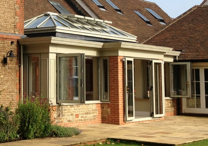 A classic double glazed orangery featuring bi fold doors and windows